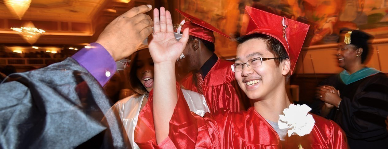 Graduate celebrating commencement