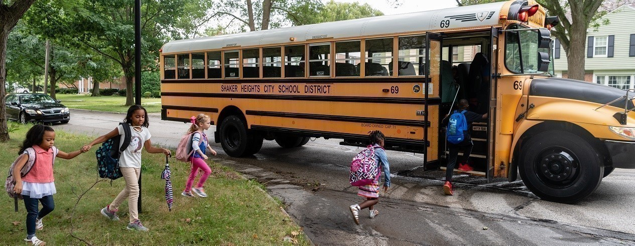 Students getting on school bus