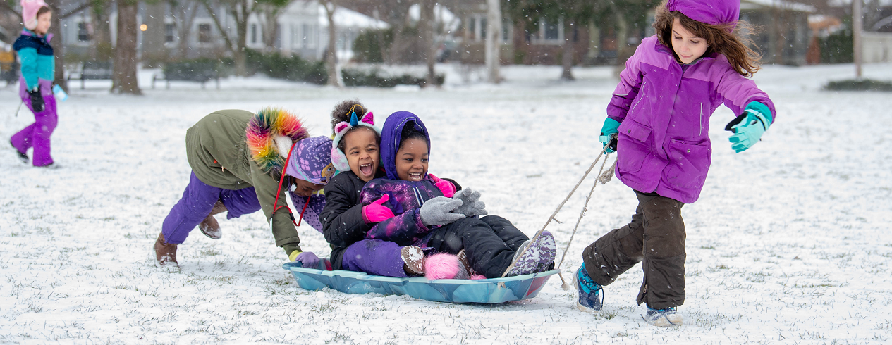 Boulevard students at recess playing in snow