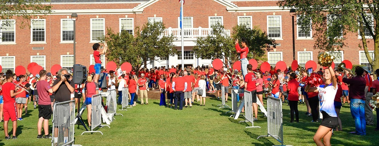 Band members and faculty/staff gather on the High School front lawn for Convocation