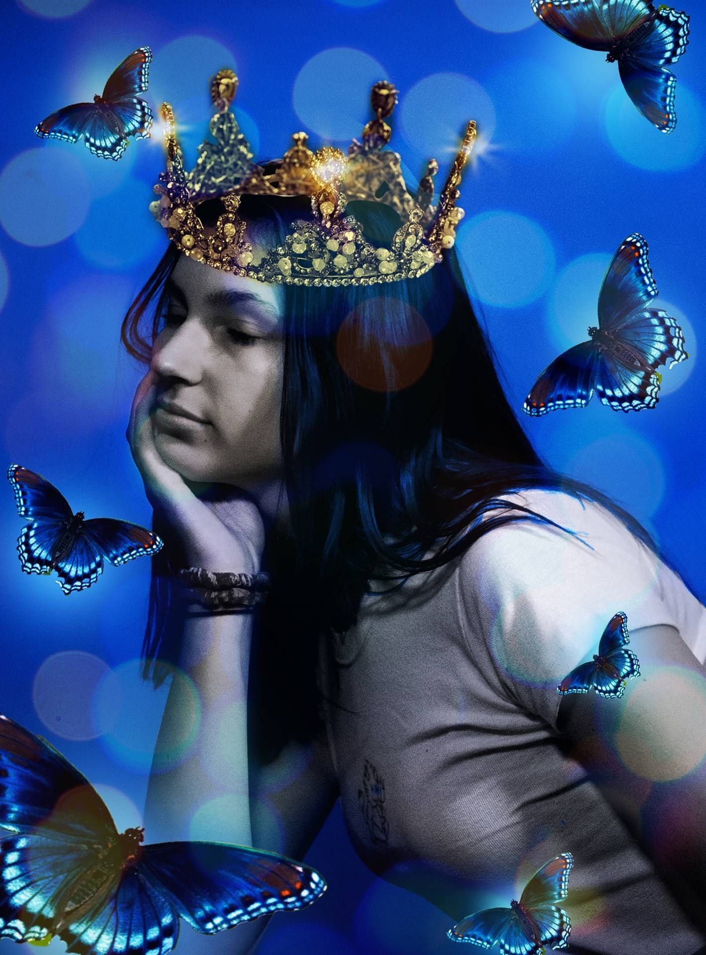 Portrait of a girl with a crown surrounded by butterflies